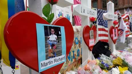 Boston remembers bomb victims, while injured learn to walk again