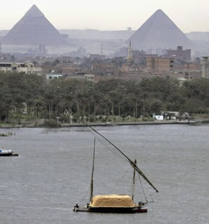 A traditional felucca sailing boat carries a cargo of hay as it transits the Nile River passing the Pyramids of Giza in Cairo, Egypt on January 22. Amr Nabil/Associated Press