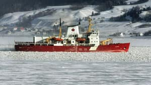 The Canadian Coast Guard icebreaker Amundsen clears a path through ice on the Saguenay river in 2005. The Amundsen is on its way back to the Arctic this summer after spending last year in dry-dock for repairs.