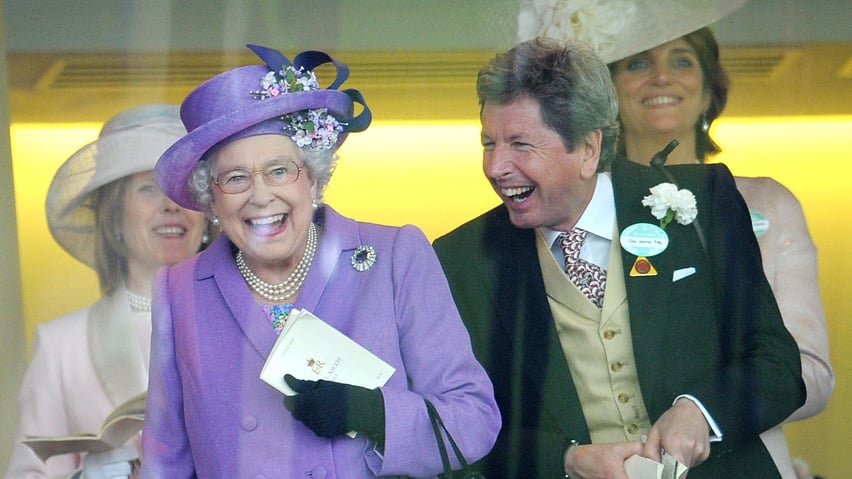 Queen Elizabeth with her racing manager John Warren react after her horse, Estimate, won the Gold Cup on day three of the Royal Ascot meeting at Ascot Racecourse, England, on Thursday