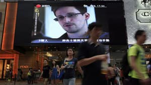 Former CIA employee Edward Snowden, who leaked top-secret files about sweeping U.S. surveillance programs to a Guardian journalist and an American filmmaker, is shown on a TV screen at a shopping mall in Hong Kong.