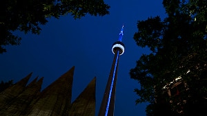 The CN Tower in Toronto went blue just after 9 p.m. ET on Monday evening in commemoration of the royal baby boy's birth. (Evan Mitsui/CBC)