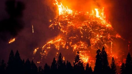 California wildfires grow as strong winds fan flames