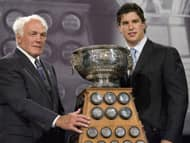 Henri Richard presents Sidney Crosby with the Art Ross Trophy in Ottawa on Saturday.