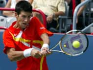 Serbia's Novak Djokovic returns against Germany's Nicolas Kiefer during Rogers Cup tennis action in Montreal on Tuesday.