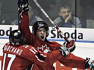 Canada's Claude Giroux celebrates his goal against Sweden with teammate Brad Marchand.