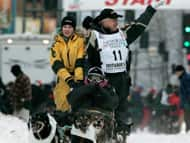Four-time Iditarod Trail Sled Dog Race champion Jeff King drives his team from the ceremonial start of the 1,700-kilometre sled dog race to Nome, Alaska, on Saturday, carrying a guest for the special ride.