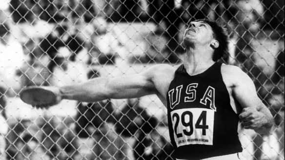 Al Oerter of the USA throws the discus at the Mexico Olympic Games.