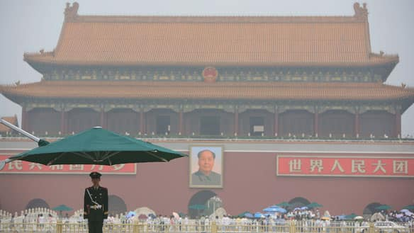 A Chinese policeman stands guard on the Tiananmen Square on July 28, 2008 in Beijing, China.