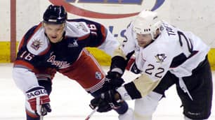 Sean Avery, left, battles for the puck while playing for the Hartford Wolf Pack on Feb. 25 in Wilkes-Barre, Pa.