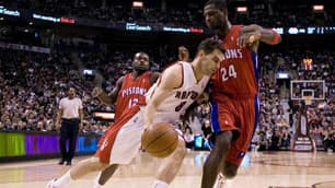 Jose Calderon, left, tries to drive past Pistons big man Antonio McDyess in the second quarter.