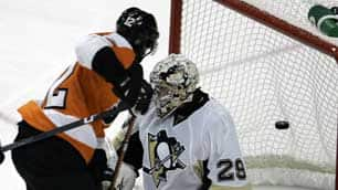 Philadelphia's Simon Gagne, left, watches teammate Mike Richards's shot head into the back of the net past Pittsburgh goalie Marc-Andre Fleury during Sunday's game.