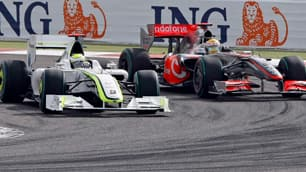 Brawn GP driver Jenson Button, left, overtakes Lewis Hamilton of McLaren Mercedes during the opening lap of the Bahrain Formula One Grand Prix.