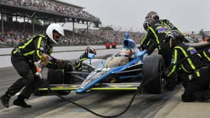 Alex Tagliani makes a pit stop during the 93rd running of the Indianapolis 500 on Sunday.