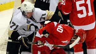 Pittsburgh's Evgeni Malkin, left, takes a shot at Henrik Zetterberg late in Game 2.