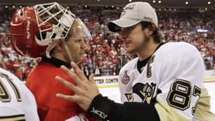 Sidney Crosby, right, shook hands with goalie Chris Osgood but missed half of the other Red Wings after Game 7 of the Stanley Cup final.