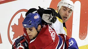 Tom Kostopoulos, left, ranked second on the Montreal Canadiens in hits and penalty minutes last season.