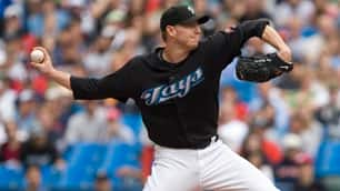 Toronto Blue Jays pitcher Roy Halladay mows down the Boston Red Sox on Sunday afternoon.