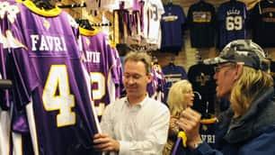 Ted Herzog, left, and Carl Brunsky look at the new Minnesota Vikings' Brett Favre (4) replica jerseys on sale at the Vikings Locker Room store on Wednesday in Minnetonka, Minn.