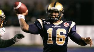 Winnipeg Blue Bombers' quarterback Michael Bishop gets the ball away despite pressure from Edmonton Eskimos defenders in first-half action in Winnipeg on Friday.