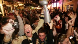 Saints fans celebrate on Bourbon Street in the French Quarter of New Orleans after the Saints defeated the Indianapolis Colts for the Super Bowl title on Sunday.