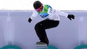 Canada's Maelle Ricker soars off a jump during women's snowboard cross event at Cypress Mountain on Tuesday.
