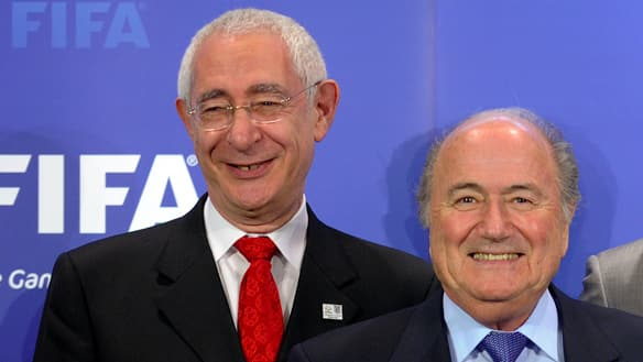 Fromer England World Cup bid chairman Lord Triesman, left, with FIFA president Sepp Blatter.