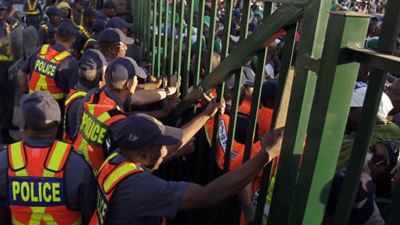 Police officers stand next to the gates prior to the warmup match between North Korea and Nigeria in Johannesburg on Sunday.