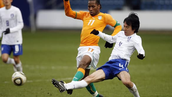 Ivory Coast striker Didier Drogba, left, vies with South Korea defender Cho Yong-Hyung, right, during their international friendly football match at Loftus Road Stadium in London, England, on March 3, 2010.