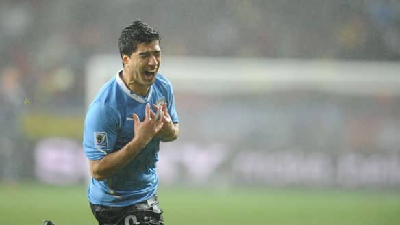 Uruguay's striker Luis Suarez celebrates after scoring his team's second goal against South Korea.
