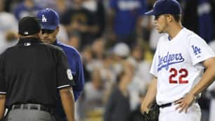 Los Angeles Dodgers manager Joe Torre, talks with Adrian Johnson after the home plate umpire ejected Los Angeles Dodgers starting pitcher Clayton Kershaw in the seventh inning on Tuesday.