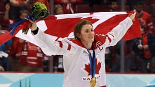 Hayley Wickenheiser celebrates after winning gold.