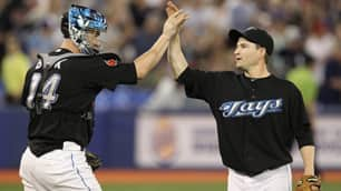 Toronto relief pitcher Jason Frasor, right, earned $2.65 million US last season. (Darren Calabrese/Canadian Press)