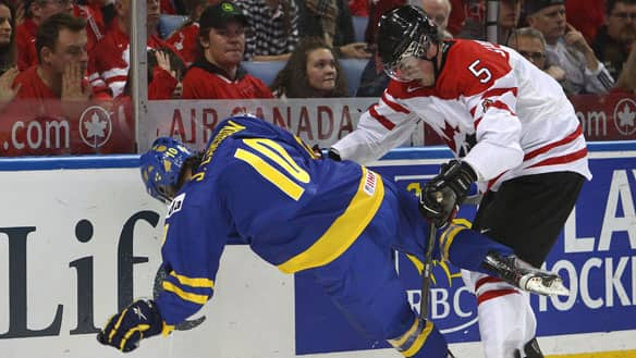 Erik Gudbranson, right, provided a towering presence on the Canadian blue-line at the world junior championship in Buffalo.