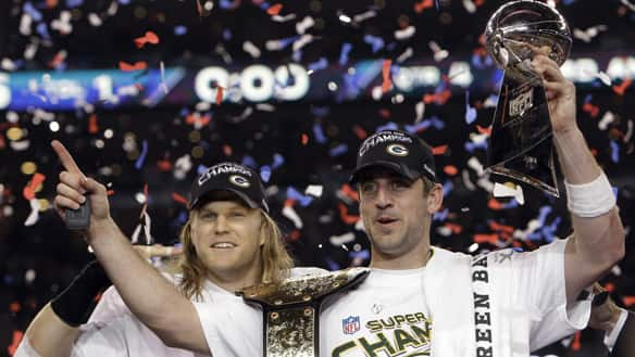Green Bay Packers quarterback Aaron Rodgers, right, and linebacker Clay Matthews, left, both won their first career Super Bowls. (Mark Humphrey/Associated Press)  www.cbc.ca