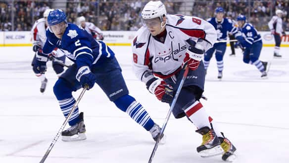 Capitals forward Alexander Ovechkin, right, eludes defenceman Luke Schenn in a 4-1 victory over the Leafs on Jan. 22.