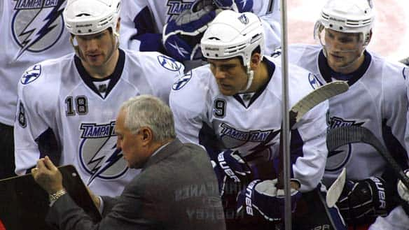 Tampa assistant coach Wayne Fleming, foreground, has worked for six NHL teams during a long career that has included an Olympic gold medal.