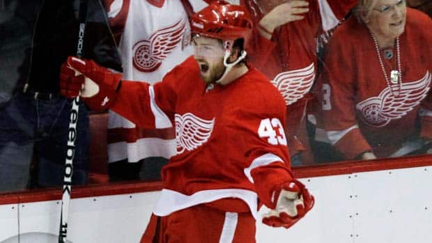 Red Wings centre Darren Helm celebrates his game-winning goal against the San Jose Sharks Friday night at Joe Louis Arena.