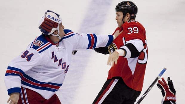 Derek Boogaard, left, begins his 70th and final NHL fight, with Ottawa Senators' Matt Carkner, on Dec. 9, 2010. He would suffer a concussion and injured shoulder and miss the rest of the season.