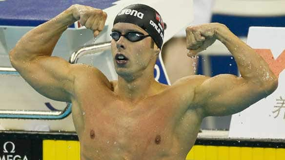 Norway's Alexander Dale Oen celebrates his victory in the men's 100-metre breaststroke Monday in China.