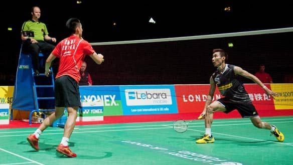 Chen Jin of China, left, returns a shot to Lee Chong Wei of Malaysia during the men's singles semifinals at the world badminton championships Saturday in London.