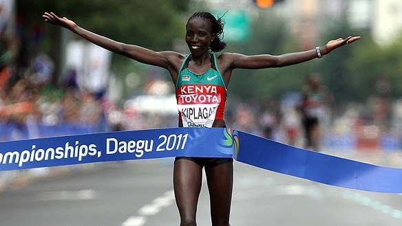 Edna Kiplagat of Kenya crosses the line before the rest in the women's marathon, the first medal event at the world championships in Daegu.