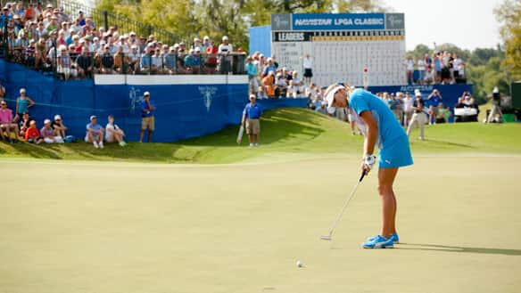 Lexi Thompson holes the tournament-clinching putt in Sunday's final round in Prattville, Ala.