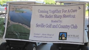 A banner is tacked on a pair of golf carts to publicize the Bader/Sharp Shootout hosted by LPGA golfer Alena Sharp of Hamilton on September 22, 2011. (Alena Sharp)