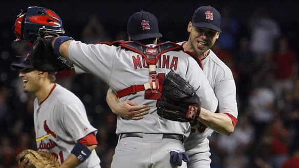 Pitcher Chris Carpenter, right, and catcher Yadier Molina of the St. Louis Cardinals celebrate their win over the Houston Astros which pushed them into the playoffs on Wednesday.