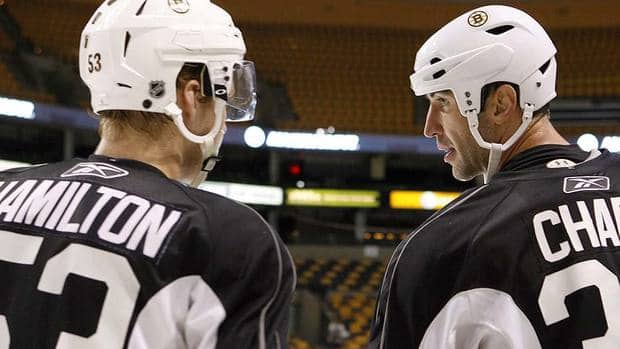 Canadian junior defenceman Dougie Hamilton, left, is seen talking with Bruins captain Zdeno Chara at the NHL team's training camp in September. Chara took Hamilton under his wing, helping the youngster during drills and offering advice on passing and positioning in the defensive zone.