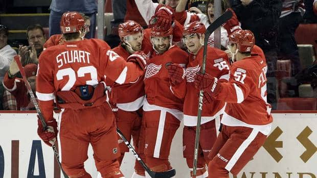 Detroit Red Wings' Henrik Zetterberg, centre, celebrates his goal with defenceman Brad Stuart, from left, defenceman Niklas Kronwall, winger Jiri Hudler, and centre Valtteri Filppula on Monday.