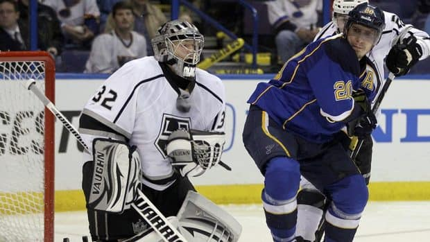 Los Angeles Kings goalie Jonathan Quick, left, makes a save in front of St. Louis Blues' Alexander Steen during the second period on Saturday.