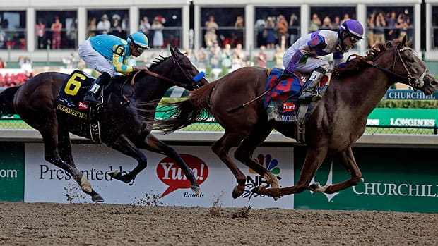 Jockey Mario Gutierrez rides I'll Have Another, right, to victory over Bodemeister at the 138th Kentucky Derby on Saturday.