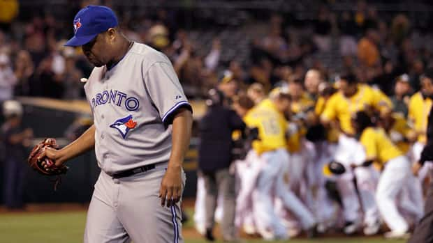 Jays pitcher Francisco Cordero walks off the field after surrending a game-ending grand slam against the Oakland Athletics on Tuesday.